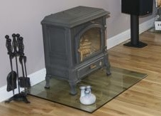 Cast iron log-burner sitting on 12mm thick glass plinth